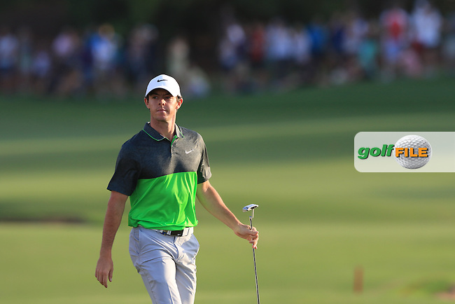 Rory McIlroy (NIR) salutes the crowd while walking up the 18th fairway during Round 3 of the DP World Tour Championship at the Earth course,  Jumeirah Golf Estates in Dubai, UAE,  21/11/2015.<br /> Picture: Golffile | Thos Caffrey<br /> <br /> All photo usage must carry mandatory copyright credit (&copy; Golffile | Thos Caffrey)