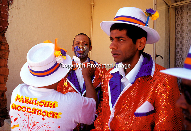 "dippcoo00044 .People. Coons.  Cape Minstrels CAPE TOWN, SOUTH AFRICA - JANUARY 2: Unidentified member of the Fabulous Woodstock starlights is preparing for the yearly ""Coon Carnival"" on January 2, 2003 in Woodstock outside Cape Town, South Africa. The carnival performers are primarily mixed-race, or colored people and the carnival began in the early 19th century when slave bands played friendly competition during the annual Jan. 2 slave holiday. The parade has become a popular tourist attraction and the colorful floats are competing at a local stadium for days for the best costumes and performances..©Per-Anders Pettersson/iAfrika Photos.."