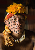 Xingu Indigenous Park, Mato Grosso State, Brazil. Aldeia Morena; warrior Yawapi Kamaiura with war paint and earned  jaguar claw necklace.