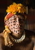 Xingu Indigenous Park, Mato Grosso State, Brazil. Aldeia Morena; warrior Yawapi Kamaiura with war paint and earned  jaguar claw necklace.