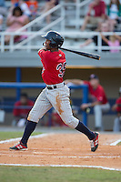 Ariel Montesino (35) of the Elizabethton Twins follows through on his swing against the Kingsport Mets at Hunter Wright Stadium on July 9, 2015 in Kingsport, Tennessee.  The Twins defeated the Mets 9-7 in 11 innings. (Brian Westerholt/Four Seam Images)