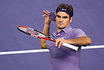 SHANGHAI, CHINA - OCTOBER 16:  Roger Federer of Switzerland celebrates by throwing his wrist sweat band to the crowd at the end of his match against Novak Djokovic of Serbia during day six of the 2010 Shanghai Rolex Masters at the Shanghai Qi Zhong Tennis Center on October 16, 2010 in Shanghai, China.  (Photo by Victor Fraile/The Power of Sport Images) *** Local Caption *** Roger Federer