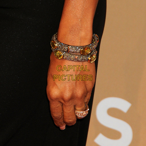 HOLLY ROBINSON PEETE's hand .CNN Heroes: An All-Star Tribute 2010 held at the Shrine Auditorium, Los Angeles, California, USA, .20th November 2010..detail bracelets bangles ring gold sparkly .CAP/ADM/BP.©Byron Purvis/AdMedia/Capital Pictures.