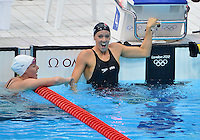 July 29, 2012..Dana Vollemer reacts after winning women's 100m Butterfly final event with a new world and olympic record at the Aquatics Center on day two of 2012 Olympic Games in London, United Kingdom.