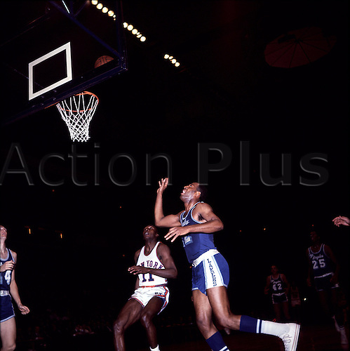 1960's:  Elgin Baylor of the Los Angeles Lakers with a shot during a Lakers game versus the New York Knickerbockers at Madison Square Garden in Manhattan, New York..