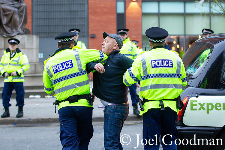 © Joel Goodman - 07973 332324 . 13/05/2012 .  Manchester , UK . Police move in after minor disturbances amongst Manchester City Football Club fans during celebrations in Piccadilly Gardens in Manchester City Centre after MCFC wins the Premiership title . Photo credit: Joel Goodman