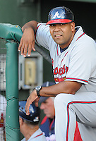 Coach Carlos Mendez (38) of the Rome Braves, Class A affiliate of the Atlanta Braves, prior to a game against the Greenville Drive on July 17, 2011, at Fluor Field at the West End in Greenville, South Carolina. (Tom Priddy/Four Seam Images)