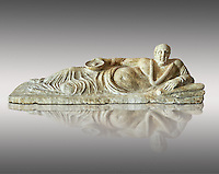 Etruscan Hellenistic style cinerary, funreary, urn cover with a man,  National Archaeological Museum Florence, Italy , against grey