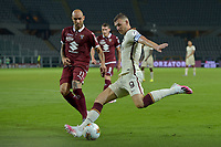29th July 2020; Olympic Grande Torino Stadium, Turin, Piedmont, Italy; Serie A Football, Torino versus Roma; Edin Dzeko of AS Roma has a shot at goal