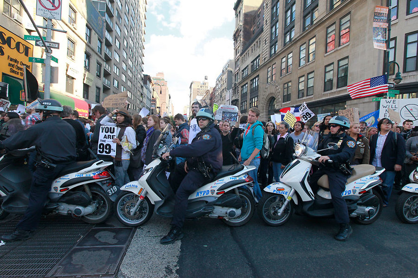 Occupy Wall Street protesters march up 6th Ave from W. 14th Street to Times Square, NYC on Saturday, October 15, 2011.