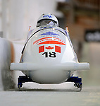 15 December 2007: Canada 2 pilot Kaillie Humphries, with Shelly-Ann Brown on the brakes, head down the straightaway towards Turn 16 during their second run of the FIBT World Cup Bobsled Competition at the Olympic Sports Complex on Mount Van Hoevenberg, at Lake Placid, New York, USA. Canada 2 took the Bronze Medal for their third place finish at the event...Mandatory Photo Credit: Ed Wolfstein Photo