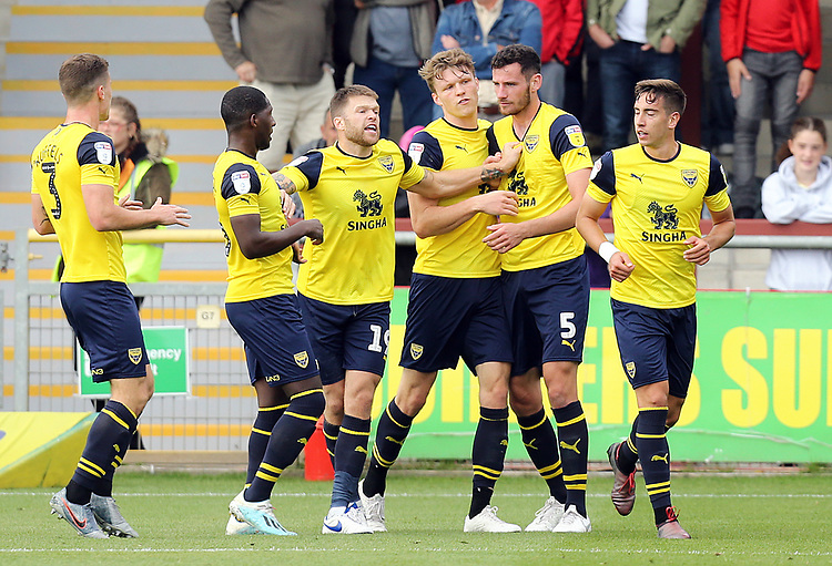 Oxford United's Elliott Moore (2nd right) celebrates with team-mates after scoring his sides equalising goal to make the score 1-1<br /> <br /> Photographer Rich Linley/CameraSport<br /> <br /> The EFL Sky Bet League One - Fleetwood Town v Oxford United - Saturday 7th September 2019 - Highbury Stadium - Fleetwood<br /> <br /> World Copyright © 2019 CameraSport. All rights reserved. 43 Linden Ave. Countesthorpe. Leicester. England. LE8 5PG - Tel: +44 (0) 116 277 4147 - admin@camerasport.com - www.camerasport.com