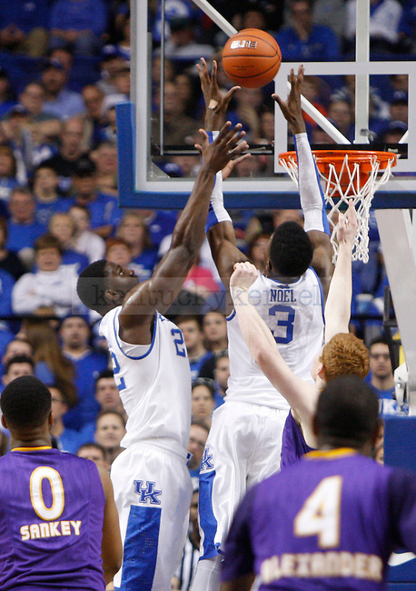 UK forward Nerlens Noel and forward Alex Poythress jump to catch a rebound ball during the first half of the UK men's basketball vs. Lipscomb University at Rupp Arena in Lexington, Ky., on Saturday, December 15, 2012. Photo by Tessa Lighty | Staff