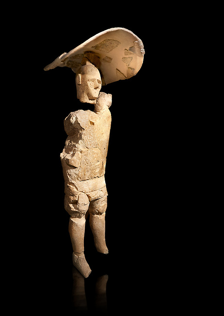 9th century BC Giants of Mont'e Prama  Nuragic stone statue of a boxer, Mont'e Prama archaeological site, Cabras. Museo archeologico nazionale, Cagliari, Italy. (National Archaeological Museum) - Black Background