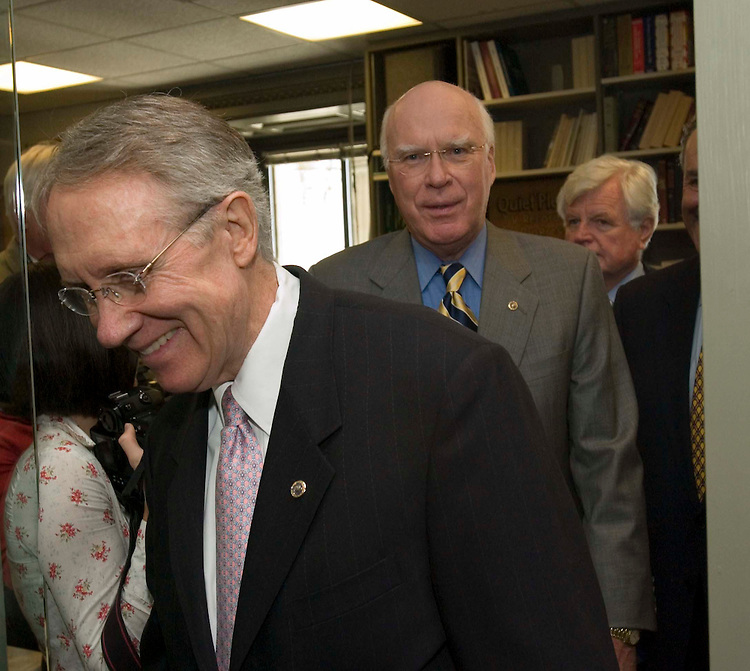 06/22/05.SENATE DEMOCRATS URGE BUSH TO CONSULT THEM ON NEXT SUPREME COURT NOMINEE--Senate Minority Leader Harry Reid, D-Nev., leads Sen. Patrick J. Leahy, D-Vt., Sen. Edward M. Kennedy, D-Mass., and Sen. Charles E. Schumer, D-N.Y. (obscured), into a news conference urging President Bush to consult them regarding who he should nominate should there be a vacancy on the Supreme Court. The ailing Chief Justice William H. Rehnquist is widely expected to retire at the end of the term. .CONGRESSIONAL QUARTERLY PHOTO BY SCOTT J. FERRELL