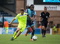 Marcus Bean of Wycombe Wanderers and Tom Lapslie of Colchester United battle in midfield during the Sky Bet League 2 match between Wycombe Wanderers and Colchester United at Adams Park, High Wycombe, England on 27 August 2016. Photo by Liam McAvoy.