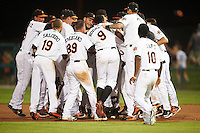 Frederick Keys left fielder Jay Gonzalez (hidden) is mobbed by teammates, including Luis Gonzalez (48), Erick Saucedo (19), Cameron Kneeland (39), Aderlin Rodriguez (9), Jonah Heim (6), Josh Hart (10), after a walk off base hit during a game against the Carolina Mudcats on June 4, 2016 at Nymeo Field at Harry Grove Stadium in Frederick, Maryland.  Frederick defeated Carolina 5-4 in eleven innings.  (Mike Janes/Four Seam Images)
