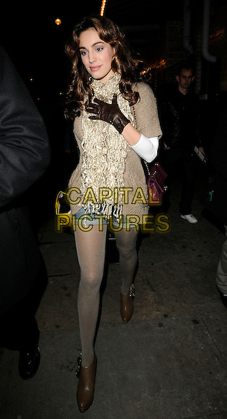 "KELLY BROOK.Leaving after her evening performance in ""Calendar Girls"", Noel Coward Theatre, London, England, UK,.November 24th 2009..full length denim shorts cut offs brown tights ankle boots leather gloves cardigan cream beige scarf suitcase on wheels bag luggage walking grey gray .CAP/CAN.©Can Nguyen/Capital Pictures."