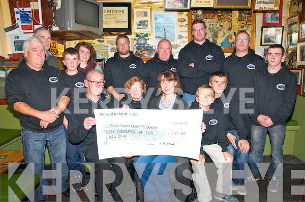 Cheque Presentation: Members of the North Kerry Sea Fishing Club presenting a cheque to the Listowel North Kerry MS society at Finnucane's Bar, Ballylongford on Sunday nifgt last. Front : Maurice Heffernan, Aidan Long, Michael Healy, Blanche Rutland, Claire Healy, Michael and Darragh Lynch & Liam Heffernan. Back l-r: Thomas Costello, Diana Healy, Peter Stack, mike O'Neill, James allman & Richard Rutland.