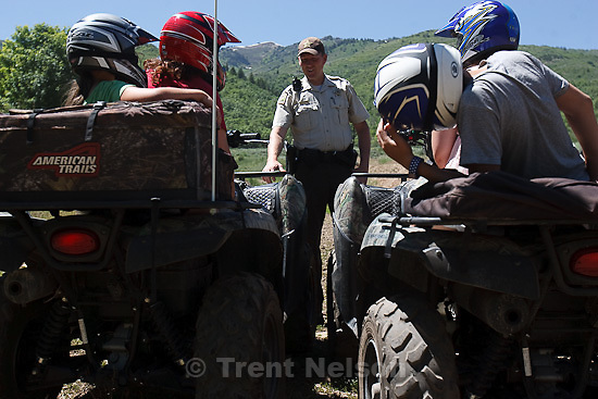 Trent Nelson  |  The Salt Lake Tribune.Ranger Drew Patterson compliments a group of riders on their use of helmets while patrolling Wasatch Mountain State Park in Midway, Utah on Saturday, July 2, 2011