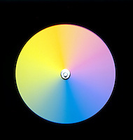 NEWTON'S COLOR DISK (3 of 4)<br /> Fast Spin, Colors Blurred &amp; Muddied<br /> The eye retains images for very short periods of time. As the disk spins the color impulses reaching the eye will overlap resulting in a combination of colors. The faster the impulses (spin) the less distinct the colors become until the disk looks gray.