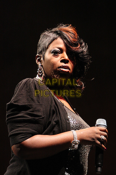 ANGIE STONE.Performing live at the Hammersmith Apollo, London, England..March 5th, 2010.stage concert gig performance music half length black jacket top   .CAP/MAR.© Martin Harris/Capital Pictures.
