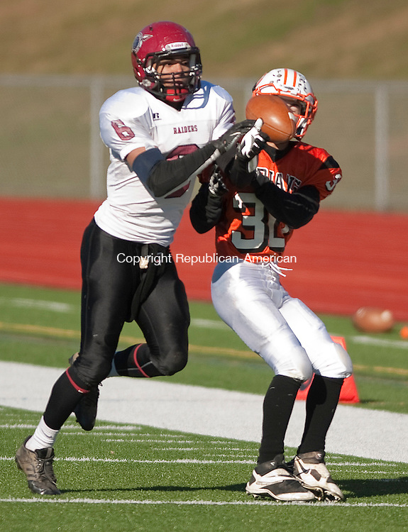 WATERTOWN, CT 112813JS19-Torrington's Manny Rijos (6) nearly picks off a pass intended from Watertown's Michael Marino (30) during their annual Thanksgiving Day game Thursday at Watertown High School. <br />  Jim Shannon Republican-American