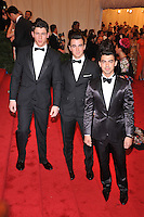 Nick Jonas, Kevin Jonas and Joe Jonas at the 'Schiaparelli And Prada: Impossible Conversations' Costume Institute Gala at the Metropolitan Museum of Art on May 7, 2012 in New York City. © mpi03/MediaPunch Inc.