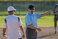 NWA Democrat-Gazette/BEN GOFF @NWABENGOFF<br /> Tim Bowling (right), base umpire, talks to Larry Lawson, Springdale Har-Ber head coach, following call Thursday, April 12, 2018, during the game between Rogers and Springdale Har-Ber at Veterans Park in Rogers.