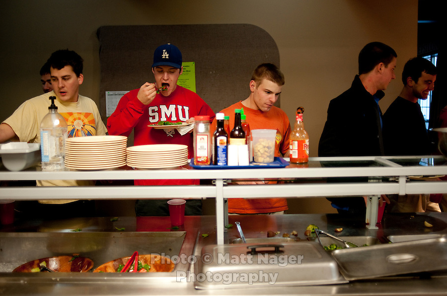 Members of the Sigma Alpha Epsilon fraternity house grab their dinner on the Southern Methodist University campus in Dallas, Texas, Friday, january 20, 2011. Some high-end chefs have found professional salvation from an unlikely location: Fraternity Row. ..Matt Nager for The Wall Street Journal