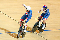 Picture by Alex Whitehead/SWpix.com - 01/03/2018 - Cycling - 2018 UCI Track Cycling World Championships, Day 2 - Omnisport, Apeldoorn, Netherlands - Ed Clancy (L) and Ethan Hayter (R) of Great Britain celebrate winning Gold in the Men's Team Pursuit final.
