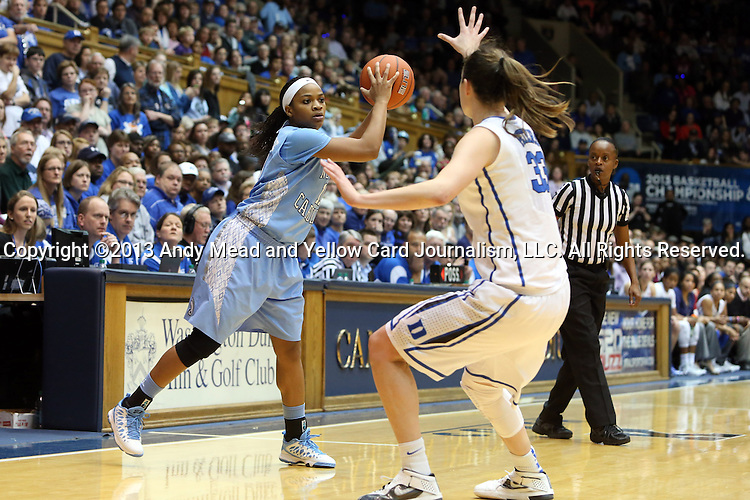 03 March 2013: North Carolina's Brittany Rountree (11) and Duke's Haley Peters (33). The Duke University Blue Devils played the University of North Carolina Tar Heels at Cameron Indoor Stadium in Durham, North Carolina in a 2012-2013 NCAA Division I and Atlantic Coast Conference women's college basketball game. Duke won the game 65-58.