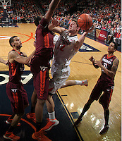Virginia guard Joe Harris (12) is surrounded by Virginia Tech defenders as he shoots the ball during the game Saturday in Charlottesville, VA. Virginia won 65-45. Photo/The Daily Progress/Andrew Shurtleff