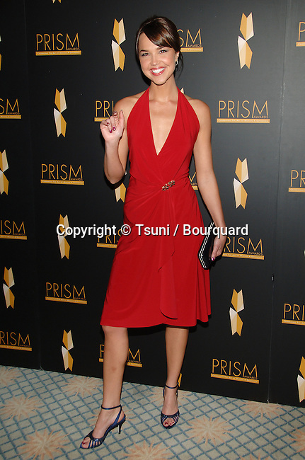 Arielle Kebbel  arriving at the PRISM AWARDS 2007 at the Beverly Hills Hotel in Los Angeles.<br /> <br /> full length<br /> eye contact<br /> smile<br /> red dress