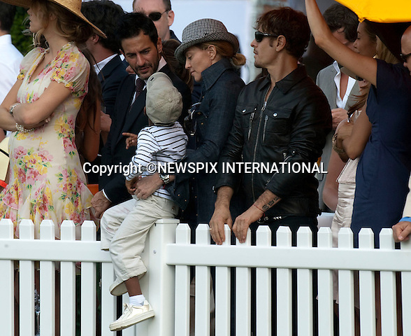 "Madonna turned up at the Veuve Clicquot Manhattan Polo Classic to cheer on Prince Harry and his Sentebale team.Madonna was accompanied by the boyfriend Jesus Luz and her children Rocco and David. The family spent the afternoon in close company with designer Marc Jacobs..Prince Harry.Attends the second annual Veuve Clicquot Manhattan Polo Classic on Governors Island.The Prince plays for the Sentebale team against the Black Watch team in a 4-chukka exhibition match_ Governors Island, New York, USA_30/05/2009.Mandatory Photo Credit: ©Dias/Newspix International..**ALL FEES PAYABLE TO: ""NEWSPIX INTERNATIONAL""**..PHOTO CREDIT MANDATORY!!: NEWSPIX INTERNATIONAL(Failure to credit will incur a surcharge of 100% of reproduction fees)..IMMEDIATE CONFIRMATION OF USAGE REQUIRED:.Newspix International, 31 Chinnery Hill, Bishop's Stortford, ENGLAND CM23 3PS.Tel:+441279 324672  ; Fax: +441279656877.Mobile:  0777568 1153.e-mail: info@newspixinternational.co.uk"
