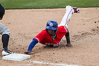 Round Rock Express second baseman Jurickson Profar #10 dives back to first during a pick off attempt against the Omaha Storm Chasers in the Pacific Coast League baseball game on April 7, 2013 at the Dell Diamond in Round Rock, Texas. Omaha beat Round Rock 5-2, handing the Express their first loss of the season. (Andrew Woolley/Four Seam Images).