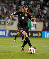 Mexico's Gerardo Torrado dribbles the ball.  Mexico defeated Costa Rica 4-1 at the 2011 CONCACAF Gold Cup at Soldier Field in Chicago, IL on June 12, 2011.