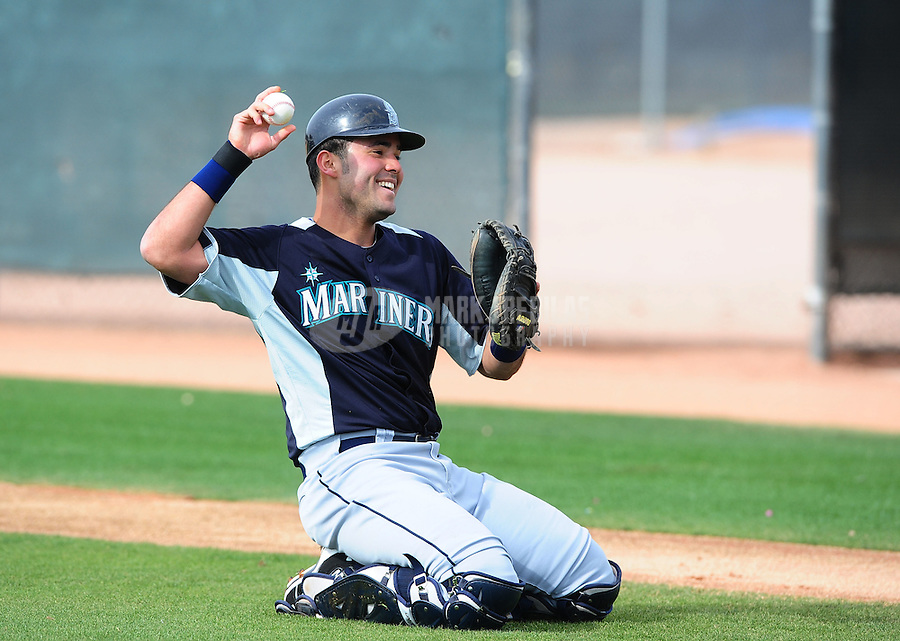 Feb. 15, 2012; Peoria, AZ, USA; Seattle Mariners catcher Jesus Montero during a pitchers and catchers workout at the Peoria Sports Complex.  Mandatory Credit: Mark J. Rebilas-.
