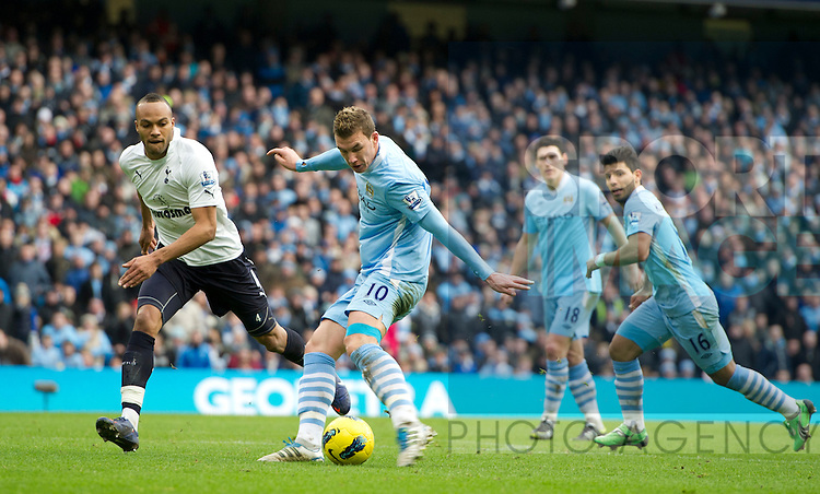 Edin Dzeko of Manchester City shoots.Barclays Premier League.Manchester City v Tottenham at the Eithad Stadium, Manchester 22nd January, 2012..Sportimage +44 7980659747.picturedesk@sportimage.co.uk.http://www.sportimage.co.uk/.Editorial use only. Maximum 45 images during a match. No video emulation or promotion as 'live'. No use in games, competitions, merchandise, betting or single club/player services. No use with unofficial audio, video, data, fixtures or club/league logos.