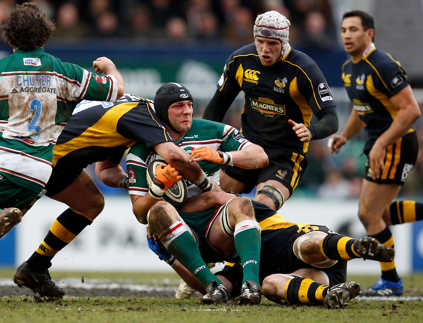 Photo: Richard Lane/Richard Lane Photography..Leicester Tigers v London Wasps. Guinness Premiership. 29/03/2008. Tigers' Ben Kay is tackled by the Wasps' defence.