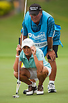 TAOYUAN, TAIWAN - OCTOBER 28:  Cristie Kerr of USA lines up a put with caddie Worth Blackwelder on the 17th green during the day four of the Sunrise LPGA Taiwan Championship at the Sunrise Golf Course on October 28, 2012 in Taoyuan, Taiwan.  Photo by Victor Fraile / The Power of Sport Images