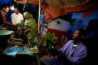 a Khat ( stimulating plant that grows in eastern africa ) vendor  markets his product in Somaliland's Capital Hargeysa main market on friday October the 19th 2007.///..Though not internationally recognized, Somaliland has a working political system, government institutions, a police force and its own currency. The territory has worked hard to win support for its claims to be a sovereign state. The former British protectorate has also escaped much of the chaos and violence that plague the rest of Somalia, although frequent clashes at the boarder with Puntland have created many problems recently. Poverty and unemployment are widely spread. the economy is highly dependent on money sent home by the diaspora..