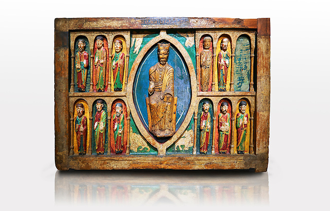 Altar of St. Maria de Taull<br /> <br /> 1200s repainted in 1579. Tempera on wood with carvings from the church of Santa Maria in Snowshoe, Vall de Boi, High Ribagorca, Spain.<br /> <br /> Acquisition of Museums Board's campaign in 1932. MNAC 3904<br /> <br /> Thirteenth century Romanesque carved and painted altar front with Christ Pantocrator in a Mandorla flanked by the 12 Apostles.  Carved altar frontals were not rare in Romanesque. Generally the characters were sculpted separately and then added to the front surface. The high quality of carving indicates the presence of a sculptures hand. The sharpness of forms to make stereotypical costumes seem versed in the work of stone sculpture.