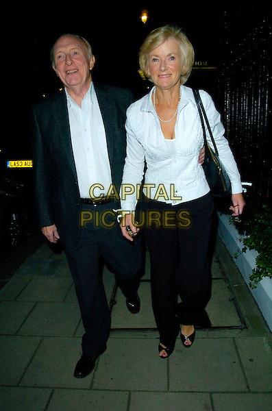 NEIL KINNOCK & GLENYS KINNOCK.Spotted outside Claridge's Hotel, London, England, October 14th 2007..full length black suit white shirt jacket trousers married husband wife                                                    .CAP/CAN.©Can Nguyen/Capital Pictures