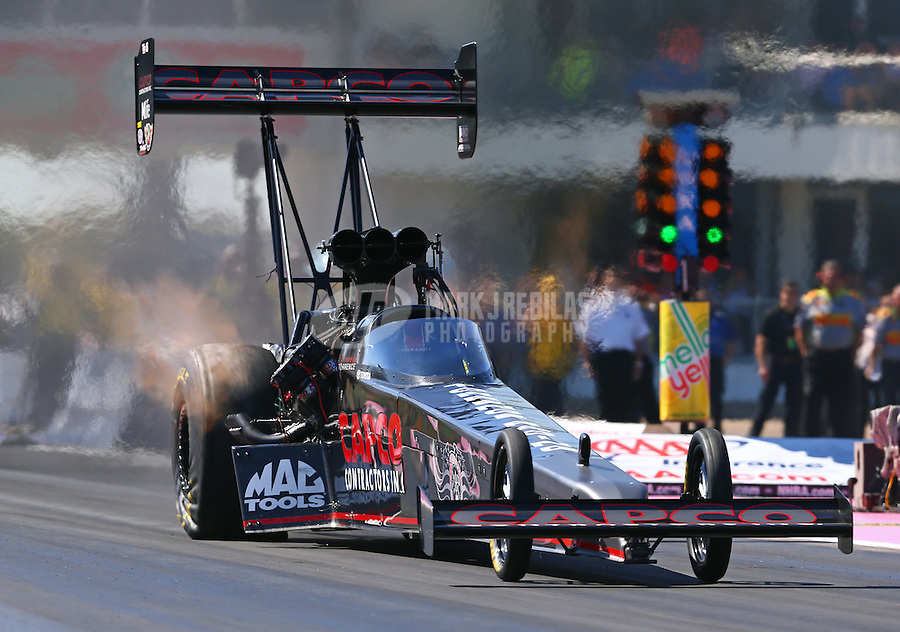 Oct 18, 2015; Ennis, TX, USA; NHRA top fuel driver Steve Torrence during the Fall Nationals at Texas Motorplex. Mandatory Credit: Mark J. Rebilas-USA TODAY Sports