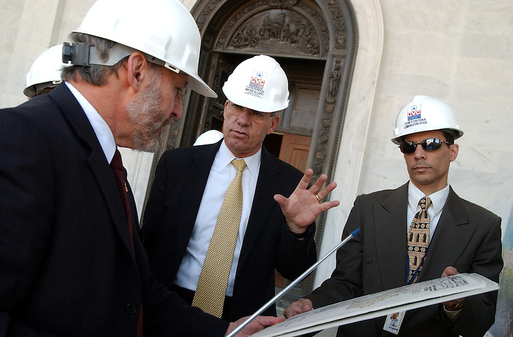 Sen. Wayne Allard, R-Colo., center, look over a plan before a tour of the Capitol Visitor Center constuction site, by Architect of the Captiol, Alan Hantman, right, and Tom Fonatana, commincations director of the project.