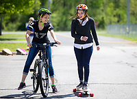 NWA Democrat-Gazette/JASON IVESTER<br /> Natasha Girenko (cq) (left), freshman, and Kelly Drake, senior, ride Tuesday, April 18, 2017, during their physical education class at New Tech High School in Rogers. Under the direction of Deb Walter, the students are in their second week of a month long mountain bike unit called Push, Pedal and Get Fit. The school received bicycles and long boards through a $30,000 grant from the George Merwin Foundation to support the class.