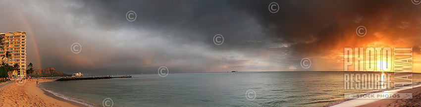 Panoramic view of the sunset from Fort DeRussy Beach, complete with Diamond Head and a rainbow.