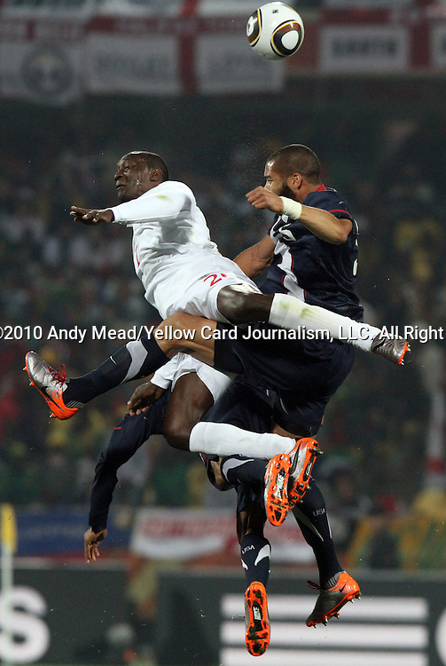 12 JUN 2010:  Emile Heskey (ENG)(21) and Oguchi Onyewu (USA)(left) compete for a head ball.  The England National Team played the United States National Team played to a 1-1 tie at Royal Bafokeng Stadium in Rustenburg, South Africa in a 2010 FIFA World Cup Group C match.