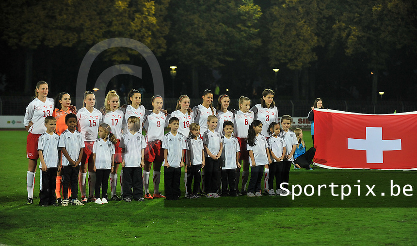 20131011 - SCHWEINFURT , GERMANY :  Swiss team pictured with Alicia Burla (1) , Carola Fasel (3) , Alison Germanier (4) , Nathalie Lienhard (6) , Charlotte Mayland (8) , Jana Schneider (10) , Sina Spieser (11) , Julie Stierli (13) , Camille Surdez (15) , Sereina Villiger (16) and Marilena Widmer (17) during the female soccer match between Germany Women U17 and Switzerland U17 , in the first game of the Elite round in group6 in the UEFA European Women's Under 17 competition 2013 in the Willy Sachs Stadium - Schweinfurt. Friday 11 October 2013. PHOTO DAVID CATRY
